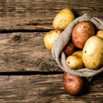 sack-of-potatoes-on-wooden-table
